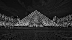 The Ghost at the Louvre (gimmeocean) Tags: pyramidedulouvre museedulouvre louvrepyramid louvremuseum louvre pyramid glasspyramid impei pyramidofthelouvre paris france bluehour le longexposure bw blackandwhite
