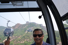 Riding the cable car to the Badaling Great Wall- can you see it in the background? (shankar s.) Tags: southeastasia china mainlandchina peking beijing beijingcapitalterritory ancienthistory thegreatwallofchina greatwall badalinggreatwall juyongguanpass defenses barrier mingdynasty tourists crowd cablecar ropeway selfie pod