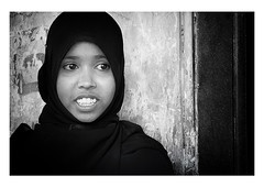a gentle shade of black (handheld-films) Tags: india muslim islam portrait portraiture woman women female girl niqab burka burqa faces people closeup individual expression statement religion eyes islamic blackandwhite monochrome