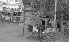The Chai Tea Vendor (peterkelly) Tags: bw digital india asia canon 6d gadventures essentialindia jaipur rajasthan bus derelict abandoned street vendor selling chai tea stall merchant
