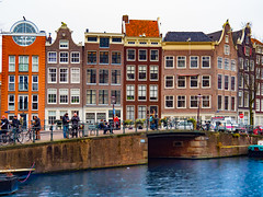 Amsterdam (jim2302) Tags: amsterdam canal boats people bikes water buildings architecture bridge