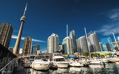 Toronto Harbourfront Centre (Ontario, Canada) (Andrea Moscato) Tags: andreamoscato canada america view vista vivid cielo clouds city città cityscape town tower torre architecture architettura buildings bridge ponte water freshwater acqua boat barche yacht porto harbor harbour shadow light luce ombre riflesso reflection blue white downtown sky skyscraper day