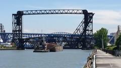 barge coming through (Tim Evanson) Tags: thomasrmorrish tugboat barge clevelandohio cuyahogariver cuyahogariverbridge liftbridge norfolksouthernrailroad