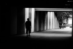 Walking Through (andersåkerblom) Tags: profile walking city blackandwhite monochrome man silhouette dark tunnel