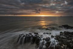 Basalt Flow (Crouchy69) Tags: sunset dusk landscape seascape ocean sea water coast clouds sky basalt rocks lighthouse beach bunbury western australia