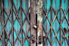 Locked for ages (Roving I) Tags: rust iron metal locks gates grills concertina empty land danang vietnam