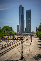 Two Towers (Fret Spider) Tags: roosevelt towers architecture rail train metra chicago downtown southloop city urban sky clouds building residence leicaaposummicron50mmf20asph manuallens sonya7ii polarizer distance two