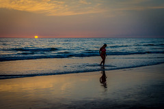 A lovely evening swim (Tony_Brasier) Tags: sky sun sunset swim woman sand sandy sailing spanish nikon lovely location cadiz spain 16mm85mm water wet running d7200