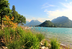 The Water's Edge (acwills2014) Tags: lakeannecy mountains grasses shoreline scenery landscape lakescape picturesque france view water lakeside