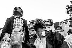Glance up (A. Yousuf Kurniawan) Tags: father son kid family streetphotography streetlife urbanlife people blackandwhite monochrome hdr moslem lowangle juxtaposition closeup