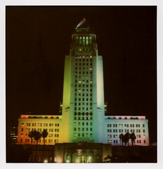 L.A. City Hall Pride (tobysx70) Tags: the impossible project tip polaroid sx70sonar sonar instant color film for sx70 type cameras impossaroid la city hall pride north spring street dtla downtown los angeles california ca lit illuminated night nocturnal rainbow lgbt lesbian gay bisexual transgender skyscraper highrise government office building palm tree silhouette toby hancock photography