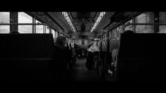 Train to Nara, Japan (emrecift) Tags: candid portrait street japan train travel analog 35mm film photography bw monochrome cinematic grain 2391 anamorphic crop canon ae1 program new fd 24mm f28 wide angle kodak tmax 100 ilfosol 3 114 emrecift filmdev:recipe=11479 kodaktmax100 ilfordilfosol3 film:brand=kodak film:name=kodaktmax100 film:iso=100 developer:brand=ilford developer:name=ilfordilfosol3