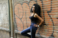 Strike That Pose (ClvvssyPhotography) Tags: woman wall street fashion africanamerican lovely beauty hair art style female jeans poses light earrings jewelry shirt black expression pose naturallighting nails