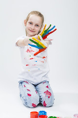 Smiling Active Caucasian Young Girl With Messy Colorful Palms While Making Handprints On T-Shirt With Hands Crossed In Front. Against White Background. (DmitryMorgan) Tags: 1 711years active againstwhite artist artistic arty caucasian cheerful child childhood color colorful colour concept craft creative creativity daughter drawing education female fingers fun gouache hand happy kid little messy multicolor one paint painter palms people playful pleasure positive preschooler smiling tshirt young