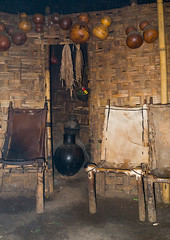 Inside a traditional Dorze house made of bamboo and enset leaves, Gamo Gofa Zone, Gamole, Ethiopia (Eric Lafforgue) Tags: abyssinia africa african bamboo buildingexterior calabash chairs day developingcountry dorze eastafrica enset ethiopia ethiopia0617590 gamogofazone gamole home hornofafrica house hut indigenousculture jars nopeople outdoors palmleaf pots poverty tall thatch thatchedroof toukoul traveldestinations tukul vertical village