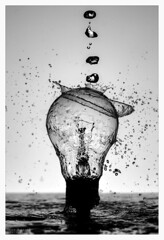 Deluge (WibbleFishBanana) Tags: splash lightbulb light bulb drop fluid water filament puddle crown
