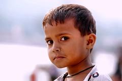 Candid Street Portraits..... Rishikesh (pallab seth) Tags: portrait streetportrait face emotion rishikesh dehradun uttarakhand india river ganga ganges hindu hinduism religion religious candid indian pilgrim pilgrimage flowerseller dailylife culture people childhood haridwar hardwar samsungnx85mmf14edssalens samsungnx1 kid boy