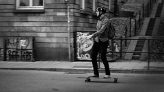 Skating home (*Lolly*) Tags: skateboard skating man city candid bw stockholm sweden summer people 50mm canon outdoor europe street