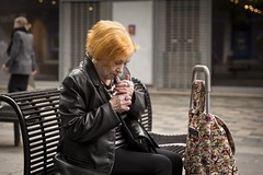 Sparking Up (Leanne Boulton) Tags: urban street candid portrait portraiture streetphotography candidstreetphotography candidportrait streetportrait streetlife sociallandscape old elderly woman female face facial expression hands gesture ginger hair redhead smoke smoker smoking cigarette black leather tone texture detail depthoffield bokeh naturallight outdoor light shade shadow city scene human life living humanity society culture people canon canon5d 5dmkiii 70mm character ef2470mmf28liiusm color colour glasgow scotland uk
