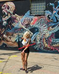 Hula Hoop Dancer, Bushwick, Brooklyn, New York City (jag9889) Tags: 2017 20170615 brooklyn bushwick dance dancer dancing detail exercise graffiti hulahoop kingscounty mural ny nyc newyork newyorkcity outdoor painting parking performance rabbit stnicholasavenue streetart tagging usa unitedstates unitedstatesofamerica wall weird woman eye jag9889 movement us tattoos