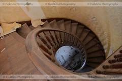 Golden Stair (ficktionphotography) Tags: abandoned abandonedbuilding abandonedrestaurant railings spiralstaircase staircase stairs urbex abandonedtraindepot urbanexploration