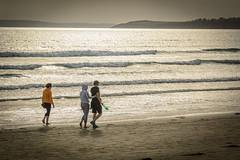 day's end (stevefge) Tags: bretagne brittany france pentrez beach sand sea ocean atlantic sunset sundown reflections reflectyourworld people candid girl horizon waves branding surf