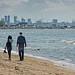 Couple Walking On The Pirita Beach