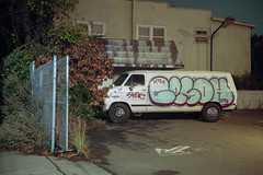 (patrickjoust) Tags: berkeley california white van graffiti fujicagw690 kodakportra160 6x9 medium format 120 rangefinder 90mm f35 fujinon lens c41 color negative film manual focus analog mechanical patrick joust patrickjoust usa us united states north america estados unidos west cable release tripod long exposure night after dark auto automobile vehicle