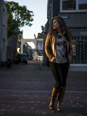 Deb, Alkmaar 2017: Catching the last sun (mdiepraam) Tags: alkmaar 2017 street bridge deb pretty beautiful brunette woman girl leatherjacket boots