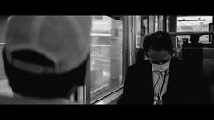 Train to Nara, Japan (emrecift) Tags: candid portrait street japan train travel analog 35mm film photography bw monochrome cinematic grain 2391 anamorphic crop canon ae1 program new fd f28 kodak tmax 100 ilfosol 3 114 emrecift filmdev:recipe=11479 kodaktmax100 ilfordilfosol3 film:brand=kodak film:name=kodaktmax100 film:iso=100 developer:brand=ilford developer:name=ilfordilfosol3