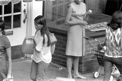h39-68 03 (ndpa / s. lundeen, archivist) Tags: nick dewolf nickdewolf bw blackwhite photographbynickdewolf film monochrome blackandwhite city summer 1968 1960s 35mm boston massachusetts candid streetphotography citylife streetlife people beaconhill charlesstreet sidewalk pedestrian youngpeople july sunday weekend july28 pedestrians business storefront window storewindow door woman youngwoman women youngwomen vacant storetolet sign brunette longhair bag bags shoulderbag suitcase stroller babystroller barefoot mailslot