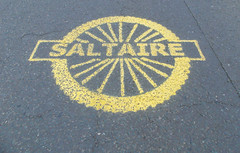 242 -  Saltaire Logo on road deck Victoria Road (1 of 1) (md2399photos) Tags: 2jun17 almshouses davidhockney robertspark saltaire saltaireunitedreformedchurch saltsmill victoriahall