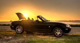Sunset behind a Mazda MX-5.