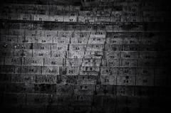 Places (Marcelo Garcia Ferreyra) Tags: black white blanco negro monocromo nikon d7000 numbers spaces grainy numeros espacio divisions divisiones spain españa madrid europe europa frame marco mistery misterio atmosfera atmosphere structure estructura stone piedra sequence secuencia repetitions repeticiones skancheli