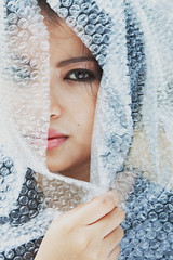 Fragile II (fourthornedrose) Tags: fragile conceptualportrait creativeportrait bubblewrap closeup piercing eyes face