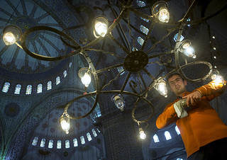 Man changing the lamps inside the Blue mosque sultan Ahmet Camii, Sultanahmet, istanbul, Turkey
