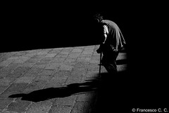 The weight of own shadow (francescocc) Tags: monochromatic monocromo monotone bw bnw bianco nero biancoenero blck white blackandwhite street strada streetphotography fotografiadistrada people person bnwstreetphotography bwstreetphotography streetphotograpy bologna bolognastreetphotography moment monochrome monocromatico foto photo pic fotografia shade shadow ombra contrasto contrast black bestphoto focus photographer exposure nikon d810 50mm