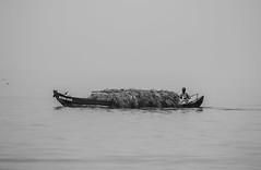 The Boatman (ajayrajanvarma) Tags: boat blackandwhite people travel india portrait kerala backwaters