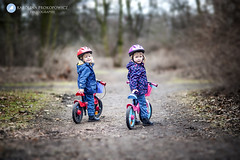 Zuzia & Marysia (karolinaprokopowicz) Tags: kids people kidsphotography bicycle forest natural girls happiness outdoor tree child sweet diamondclassphotographer
