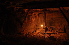 Exploring a dark cave. (Yvan S) Tags: cave cavern torch light night dark darkness explore exploring france french photography rock girder timber construction flame flaming burn burning solo alone adventurer obscurity obscure darkly man collapse ruin destroy urbex exploration career quarry stone amazing beautiful nice red yellow wood grotte torche lumière nuit sombre français photographie pierre poutre flamme seul aventurier obscurité homme détruit ruine carrière beau rouge jaune bois stand standing
