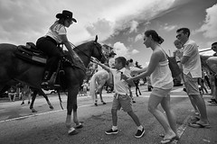 reach out and touch (Carey Moulton) Tags: keybiscayne july4thparade street decisive moment