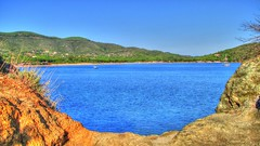 * Isola d'Elba: vista panoramica dal promontorio #2 * Panoramic view from  the headland * (argia world 1) Tags: isoladelba promontorio headland vistapanoramica panoramicview rocce rocks mare sea case house bosco wood alberi trees cielo sky barche boats
