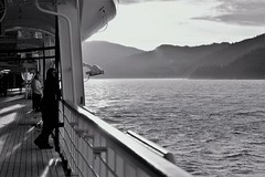 Holland America ~ evening on the promenade (karma (Karen)) Tags: canada britishcanada cruising hollandamerica mszaandam ships mountains seas bw monochrome hss sliderssunday