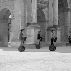 Tourists in formation flight (gambajo) Tags: paris france europe tourists outdoor blackandwhite blackwhite people street streetphotography segway segways