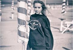 Untitled (Steve Lundqvist) Tags: sweatshirt felpa girl seaside sea mare beach spiaggia nikon 105mm hair beauty women italy adriatic adriatico face young teen teenager shorts sporty sport outdoor sunlight ritratto persone portrait
