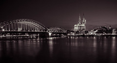 Nighttime view of Cologne Cathedral and Hohenzollern bridge (mary_hulett) Tags: night cologne rivercruise bridge reflection germany viking evening lights scene 2017 hohenzollernbridge travel musicdome europe cathedral stpeterschurch