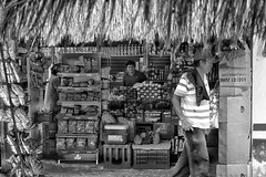 Shop keeper looks as tourist bus passes. Costa Maya,  Mexico. (astewpat25) Tags: costamaya mexico tourist shop shopkeeper shopworker blackandwhite streetphotography holiday takenwithsonyrx100 takenonsonyrx100 sonycamera editedusingsnapseed snapseed