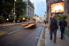 A bit of movement does not hurt ! (fdlscrmn) Tags: street cars people motion bucharest sign buildings view downtown auto longexposure