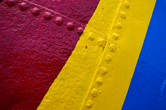 Riveting colour (James_D_Images) Tags: buoy detail closeup red yellow blue primary colours rivets seams painted vancouver britishcolumbia granvilleisland