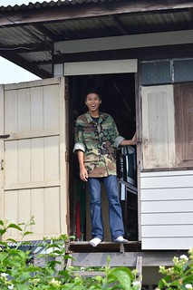 happy young man in a doorway
